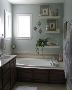 Bath panel to match sink cabinet and floating shelves for decorative items.