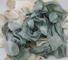 Sea shell impressions run the length of this grey scarf for sale at dragonflyislands.etsy.com