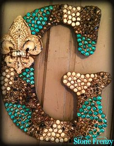 """Monogram Wooden Letter """"G"""" 24"""" with a cream Fleur de lis  and done in green teal, cream  and natural rock stones"""