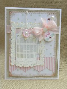 what a sweet card by Geri at paper wishes. Love it. I might try this but add a bird where the bow is?....