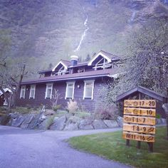 Flam Youth Hostel. Backdrop with waterfall. Very clean and good value. Equipped with complete kitchen utensils for those who want to cook.  It is worth to stay a night or two to explore the small pleasant town and not to rush to complete Norway in a nutshell in a day.