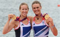 Great Britain's Helen Glover (L) and Heather Stanning pose with their gold medals on the podium of the women's pair final of the rowing event during the London 2012 Olympic Games, at Eton Dorney Rowing Centre in Eton, west of London