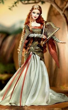 Mattel Legends of Ireland Irish St. Patricks Day The Bard Barbie Doll    ABOUT: Ancient Ireland, a reddish blond-haired beauty keeps the legends of yore.weaving yarns of mythic exploits.   As she recites her lilting lyrics, she plays a golden harp, its sweet music intriguing and alluring - captivating all who are near.     http://www.ebay.com/itm/NRFB-Mattel-Legends-of-Ireland-Irish-St-Patricks-Day-The-Bard-Barbie-Doll-NIB-/181096635591?pt=US_Dolls_Bears_Toys=item2a2a335cc7