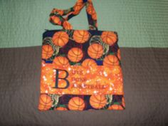 Book bag for preschooler, 13x13, pockets on the inside and out, plus a zipper to hold everything in.