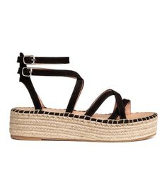 Black. Platform sandals in faux suede with braided jute trim around soles. Adjustable ankle straps with concealed elastication and metal buckle. Faux