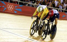 Australia's Anna Meares (L) and Britain's Victoria Pendleton (R) reach the finish line head to head in the London 2012 Olympic Games women's sprint final, race 1, cycling event at the Velodrome in the Olympic Park