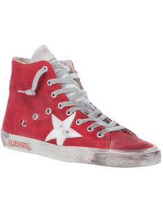 Red leather sneakers from Golden Goose featuring a worn-in effect, a star logo patch, a lace up front, silver-tone eyelets, a rear trim, a circle patch, a zip fastening to the side and a thick rubber sole.