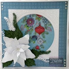 By Linda Fitzsimmons 8x8 card made from A3 Centura Pearl Papers from 12x12 Festive Wonder Pad Festive Frame Embossing Folder Festive Wonder - Pretty Poinsettia Die set White Centura Pearl – Hint of Silver Collall glue and 3d Glue gel Gems and Tacky glue Stickles
