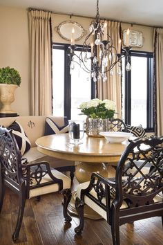Joy Tribout Interior Design  Like the use of a couch and chairs aut table