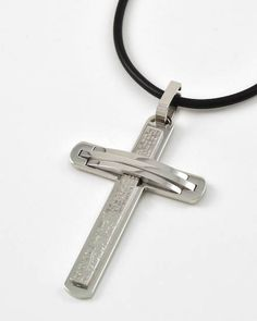 "Photo: Men's Stainless Steel cross pendant necklace on black cord, $23 •   LENGTH : 20 1/2"" •   PENDANT : 1 1/2"" W X 2 1/4"" L"