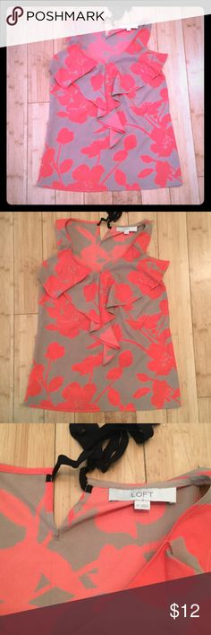 Ann Taylor Loft Tank Tan and orange flower print tank, with black bow neck closure in the back. 100% polyester. Lightly worn. Ann Taylor Tops Tank Tops