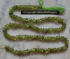 Natural peridot 4x2mm rondelle semiprecious beads 14 inch strand bs026 #Silversmithsupply #Smooth Semi Precious Beads, Peridot, Jewelry Watches, Smooth, Beaded Bracelets, Stone, Natural, Rock, Pearl Bracelets