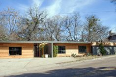 Exterior improvements include horizontal wood-plank siding, enlarged and updated windows and new landscaping that includes giant Agave cacti known as century plants.