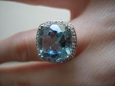 This is the 10 3/8 carat blue topaz ring with white topaz detail, set in sterling silver.  I just love it!  --Andrea