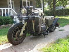 Twin 7.62 Gatling guns. Note ammo boxes for storage. Owner apparently rides it... Pure badass.