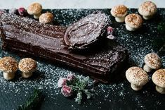 There are just about a million ways to make a yule log, but they all have three main components: cake, filling, and frosting. (Well, four if you count all of the fun bits and bobs you can use for decoration.) This recipe is a mashup of Dominique Ansel's flourless chocolate cake and Cook's Illustrated's coffee-mascarpone cream and chocolate ganache, combined with a bit of my own flourish.