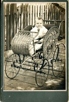 Vintage baby in wicker pram. Darling!