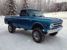 Ryan's first project. 1968 Chevy K10 pickup, green body, white top.