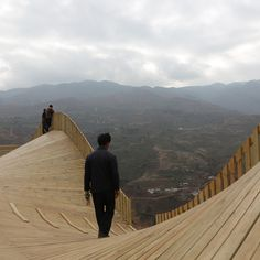 Undulating viewing platform by John Lin and Olivier Ottevaere features built-in market stalls