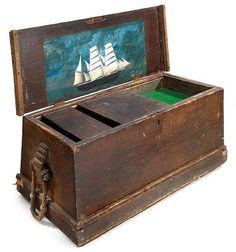 A 19th-century sailor's chest constructed in pine and of typical form, complete with inset tray with sliding lids accessing compartments and main body, a painted ship inside lid and original rope handles