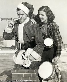 Bob Hope is seen with actress Helen Wood, left, in this 1938 gagshot of him climbing out o...