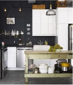 I love the contrast of new and old. I am in love with the distressed workspace and the apron sink.