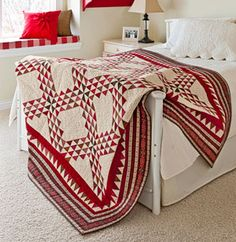 I so love a two color quilt. This one has nice depth with the variety of reds.