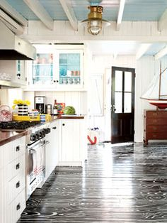 Cute kitchen! Love the ceiling and glass cupboard with aqua in back! Also love the pops of yellow!