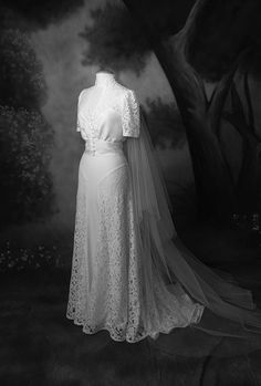 Robe de mariée dentelle corsage boutons