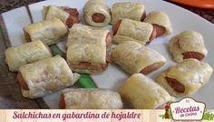 Salchichas en gabardinas de hojaldre -  Esta receta puede ser tanto un aperitivo como una buena cena divertida para los bebés. A todos los niños les gustan las salchichas, ya sean fritas en un bocadillo, cocidas en un perrito caliente o simplemente salteadas en una buena musaka de salchichas y berenjenas como hicimos el otro día. Las ... - http://www.lasrecetascocina.com/2013/10/09/salchichas-en-gabardinas-de-hojaldre/