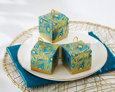 Fill these blue and gold foil peacock favor boxes with sweets for a vibrant Indian wedding, sangeet, garba or mehndi party!