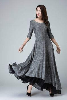 Wow, this high low dress is a stunner in gray linen with a black chiffon ruffle at the hem! Unbelievably elegant, the dress features a slightly rounded scoop neckline, extra long sleeves and a full swing, lightly pleated skirt. Great for any semi formal affair. Available in women's US sizes 0 to 18, as well as custom sizes upon request. Side zipper closure. Gray. Handmade . **Details** made with a soft gray linen and black chiffon Scoop neckline Side zipper Closure elbow sleeve style…