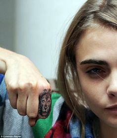 Roar: Caras first tattoo, which she got one week earlier, was a lions head on her right index finger