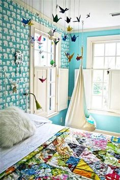 i love the idea of using the vertical space - maybe for my sunroom. must now learn origami / keep cat away from them.