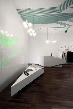 Fashion shop interior design, dynamic interiors, ceiling continuation lights