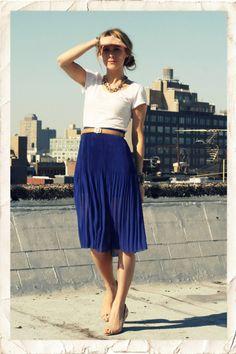 so crisp. cobalt blue high-waist pleated skirt, tan leather belt, & white t-shirt.
