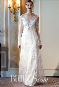 """Brides.com: . """"Pasadena,"""" embroidered tulle long sleeves and illusion front and back, with flowing skirt with cathedral length train, Claire Pettibone"""