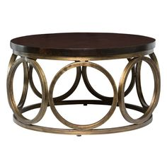 Hand crafted from high-quality mango wood and metal, the Kosas Home Gemma Round Coffee Table, brings a modern and sleek feel to any space. The handcrafted nature of this product may produce minor differences with color and or shade. Mango Wood Coffee Table, Round Wood Coffee Table, Coffee Tables, Home Design, Interior Design, Design Ideas, Wood Rounds, Furniture Companies, Business Furniture