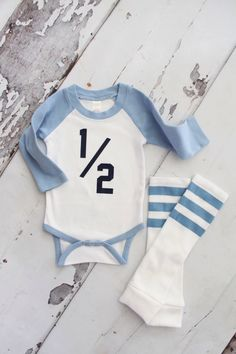 Baby Boy HALF 1/2 .5 Birthday Bodysuit and Football Striped Leg Warmers.  Althletic Jersey, Football Party, Green, Baby Blue, Navy Blue. by ChicCoutureBoutique on Etsy https://www.etsy.com/listing/286144171/baby-boy-half-12-5-birthday-bodysuit-and