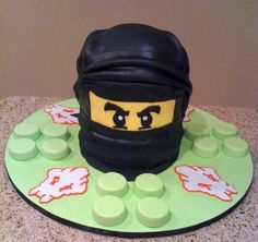 This is a cool one, too... of course, I can't make a single one of these cakes, but they sure are neat!  Lego Ninjago Cake