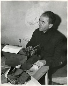 Albert Speer photographed in his cell at Nuremberg, during the Nuremberg trials. Speer was photographed working at a typewriter. November 24, 1945
