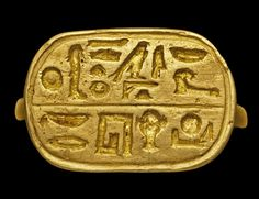 """An Egyptian electrum gold ring, circa 399-343 B.C., engraved with hieroglyphs reading """"for the Bearer of the Standard of Horus of Edfu, give protection to Hakoris""""."""