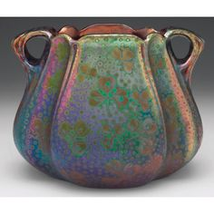 Weller Sicard vase, double handled form with a clover design, covered in a  metallic glaze with overall iridescence, unsigned, #29
