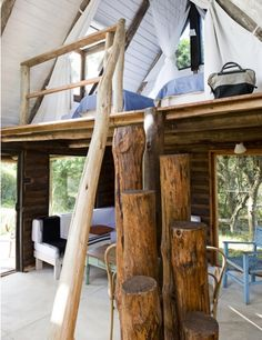 driftwood log ladder to the mezzanine level - beach shack style --- this driftwood log ladder would be cute for a loft