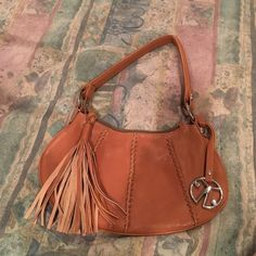 Leather Shoulder Bag Leather shoulder bag with front accent on the zipper. Has a removable metal decal with company logo. Bags Shoulder Bags