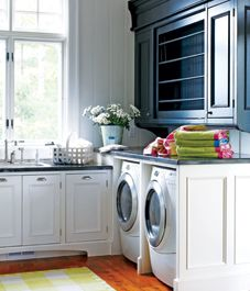 laundry room with navy and white custom cabinetry