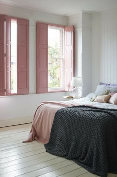Pink solid-panel shutters give this pretty bedroom design a restful feel.theshuttersto… - ALL ABOUT Bedroom Shutters, Interior Window Shutters, Bedroom Windows, Bedroom Decor, Indoor Shutters For Windows, Window Shutters Inside, Window Curtains, Bedroom Window Design, Window Headboard