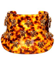 Accentuate the neck with a bee-jeweled choker