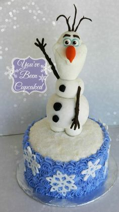 """""""Olaf"""" Cake ( He is made from rice krispy treats and fondant and is about 12"""" tall (not counting the cake)…and I even rolled him in course sanding sugar with a pinch of edible glitter, so he would looks icy.)"""