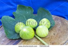 fresh tasty figs fruits on a wood plate with bread and a blue background. for healthy and natural concepts. ficus carica